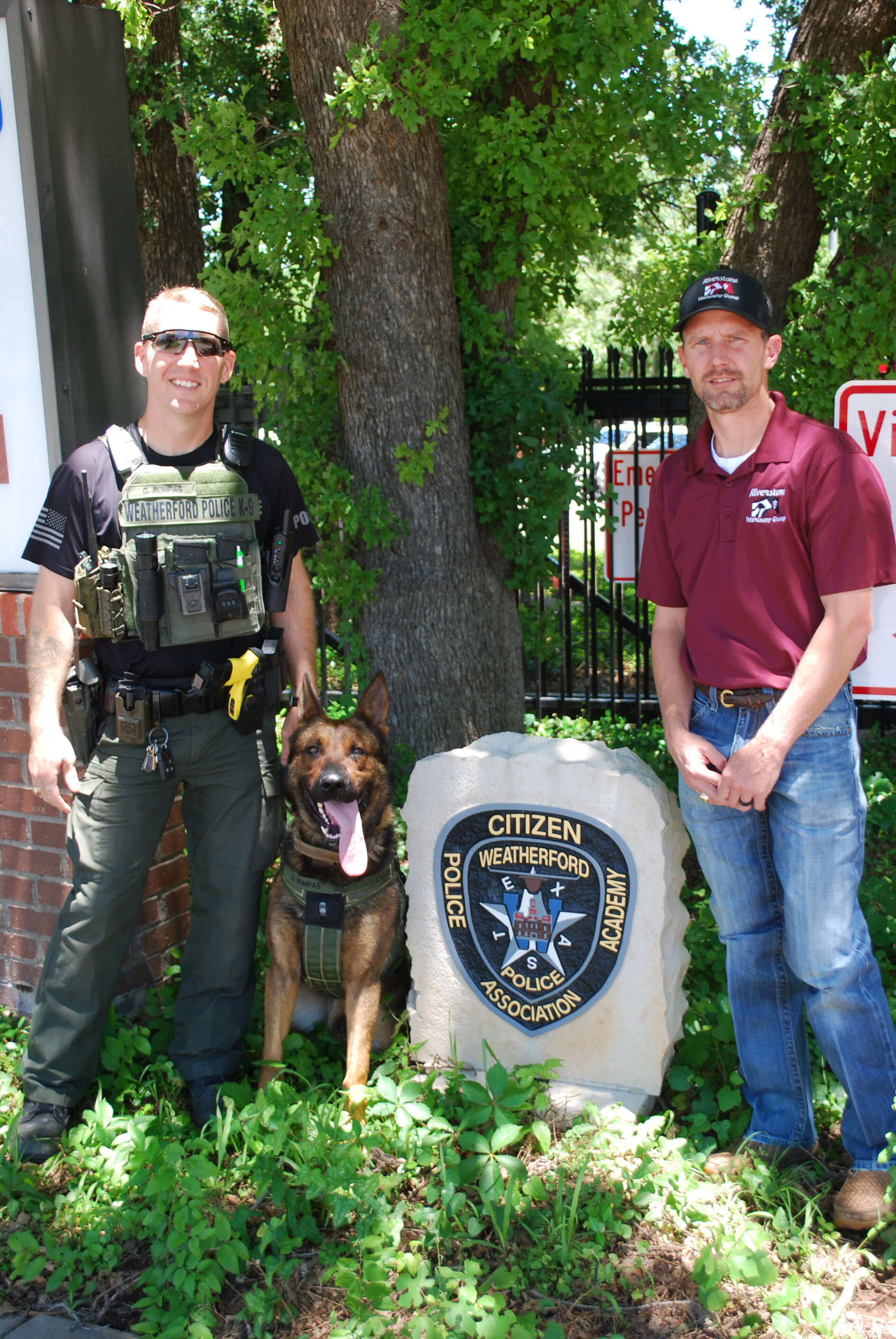 dr.cate-poses-with-k9bruce-and-officer